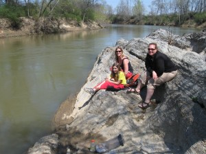 April Ingle, Jennifer Wysocki and Ramsey Cook take a lunch break near Calhoun along the Oostanaula.