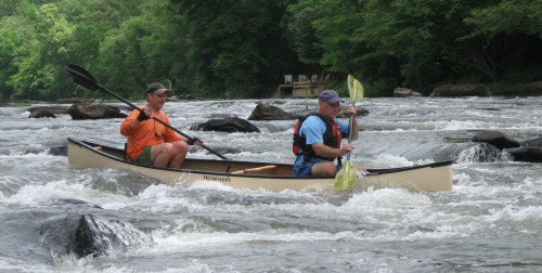 Doc Stephens and Vincent Payne navigate a ledge near the mouth of Mountaintown Creek.