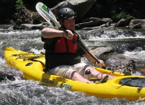 Alan Crawford manuvers through the whitewater of the Upper Coosawattee.