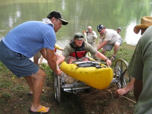"""""""The Crawford Crawler"""" in action. A specially-designed boat launch and friends helped Crawford enter and exit the river each day--even in locations with very steep banks and no boat ramps."""