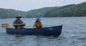 Dave & Jessa Goldman battle wind and motorboat wakes on Carters Lake.
