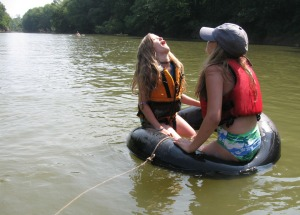 Ramsey Cook and Jessa Goldman drift along in a tube behind our canoe.
