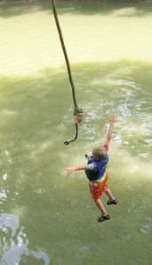 The plunge! A rope swing offers diversion on the Coosawattee River.