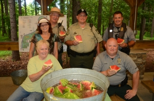 Rep. Lynn Smith (R-Newnan) far left and members of the Chattahoochee Bend State Park staff welcomed Paddle Georgia with ice cold drinks and watermelon.
